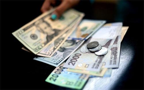 Thị trường ngoại hối toàn cầu có giá trị giao dịch lên tới 5,3 nghìn tỷ USD mỗi ngày, nên hành vi thao túng tỷ giá tiêu chuẩn của các ngân hàng có thể có ảnh hưởng rất lớn - Ảnh: Bloomberg.